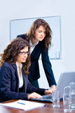 Businesswomen using laptop Stock Images