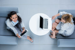 Businesswomen using laptop and digital tablet Royalty Free Stock Photography