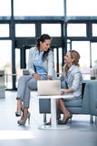 Businesswomen using laptop and having a discussion Stock Photos