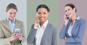 Businesswomen using mobile phone against colored background. Smiling businesswomen using mobile phone against colored background Royalty Free Stock Images