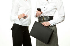 Businesswomen using mobile phones Royalty Free Stock Images