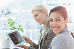 Businesswomen using tablet Stock Image