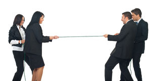 Businesswomen vs.businessmen. Two businesswomen and two businessmen playing tug war isolated on white background royalty free stock image