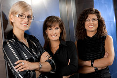 Businesswomen waiting for lift Stock Images