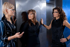 Businesswomen waiting for lift Stock Image