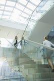 Businesswomen walking on steps in office Royalty Free Stock Photos