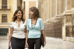 Businesswomen Walking Through Town Royalty Free Stock Images