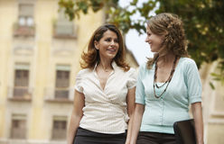 Businesswomen Walking Through Town Stock Images