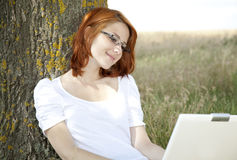 Businesswomen in white with glasses and laptop Royalty Free Stock Images