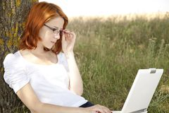 Businesswomen in white with glasses and laptop Stock Photography