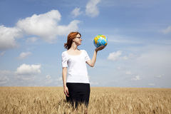 Businesswomen in white keeping globe in hand Stock Photos