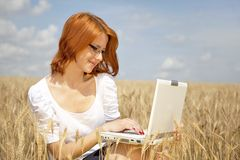 Businesswomen in white with notebook at wheat fiel Stock Image