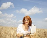 Businesswomen in white with notebook at wheat fiel Royalty Free Stock Photo