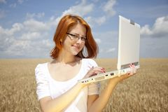 Businesswomen in white with notebook at wheat fiel Stock Photos