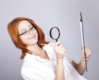 Businesswomen with white plan board and loupe Royalty Free Stock Image