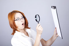 Businesswomen with white plan board and loupe Stock Image