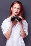 Businesswomen in white shirt with binocular Stock Images