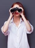 Businesswomen in white shirt with binocular Royalty Free Stock Photos