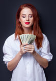 Businesswomen in white shirt with money Royalty Free Stock Image