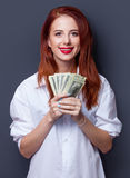 Businesswomen in white shirt with money Royalty Free Stock Photo