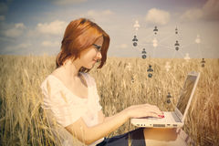 Businesswomen in white working with notebook Royalty Free Stock Photos