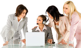 Businesswomen working. Successful team of four beautiful businesswomen talking behind laptop Stock Image