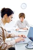 Businesswomen working Stock Images
