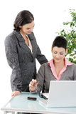 Businesswomen working at desk Royalty Free Stock Image