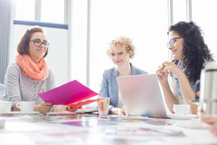 Businesswomen working at desk in creative office Royalty Free Stock Image