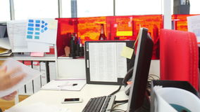 Businesswomen Working At Desks In Modern Open Plan Office. Are joined by male colleague.Shot on Sony FS700 at frame rate of 25fps stock footage
