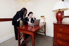 Businesswomen Working on Laptop in Office Stock Images