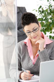 Businesswomen working in office Stock Image