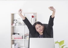 Businesswomen working at office desk. She feels bored and tried job on laptop. relax concept Royalty Free Stock Photo
