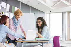 Businesswomen working together in creative office royalty free stock photography