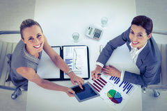 Businesswomen working together at desk Stock Photo