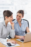 Businesswomen working together on a laptop Royalty Free Stock Image