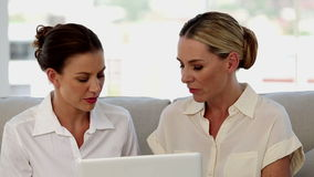 Businesswomen working together on a laptop stock footage