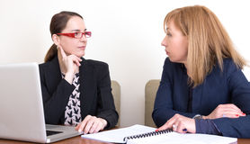Businesswomen worried. Two bussinesswomen looking each other worried, preoccupied Stock Images