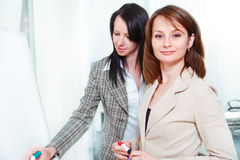 Businesswomen writing. On the whiteboard Stock Images