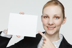 Busineswoman with blank sign Stock Photo