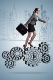 The busineswoman with cogwheels gear in teamwork concept. Busineswoman with cogwheels gear in teamwork concept Royalty Free Stock Photography