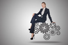 The busineswoman with cogwheels gear in teamwork concept. Busineswoman with cogwheels gear in teamwork concept Royalty Free Stock Images