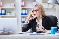 The busineswoman frustrated working in the office. Busineswoman frustrated working in the office Stock Photography
