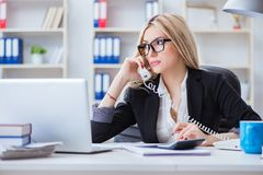 The busineswoman frustrated working in the office. Busineswoman frustrated working in the office Stock Photos