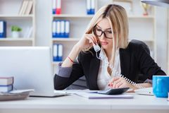 The busineswoman frustrated working in the office. Busineswoman frustrated working in the office Royalty Free Stock Images