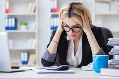 The busineswoman frustrated working in the office. Busineswoman frustrated working in the office Royalty Free Stock Photos
