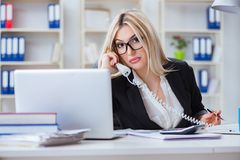 The busineswoman frustrated working in the office. Busineswoman frustrated working in the office Stock Images