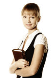Busineswoman holding notepad. Blonde busineswoman holding notepad photo over white Royalty Free Stock Image