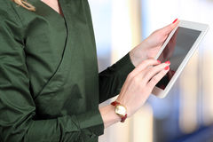 Busineswoman holding  and working with a digital tablet Royalty Free Stock Photos