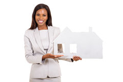 Busineswoman showing house symbol Royalty Free Stock Image